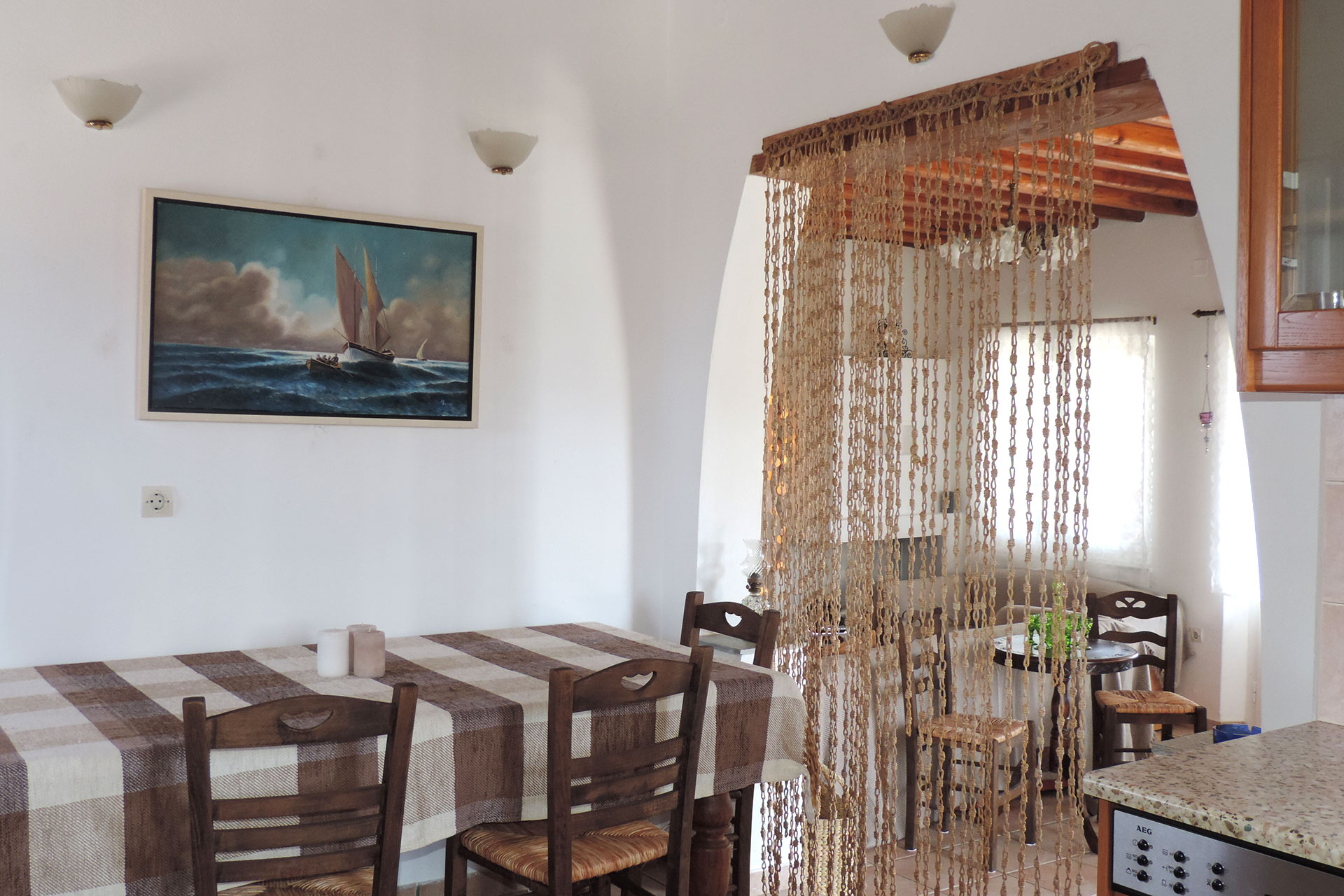 The dining area and the kitchen of Elia family house at Kavos