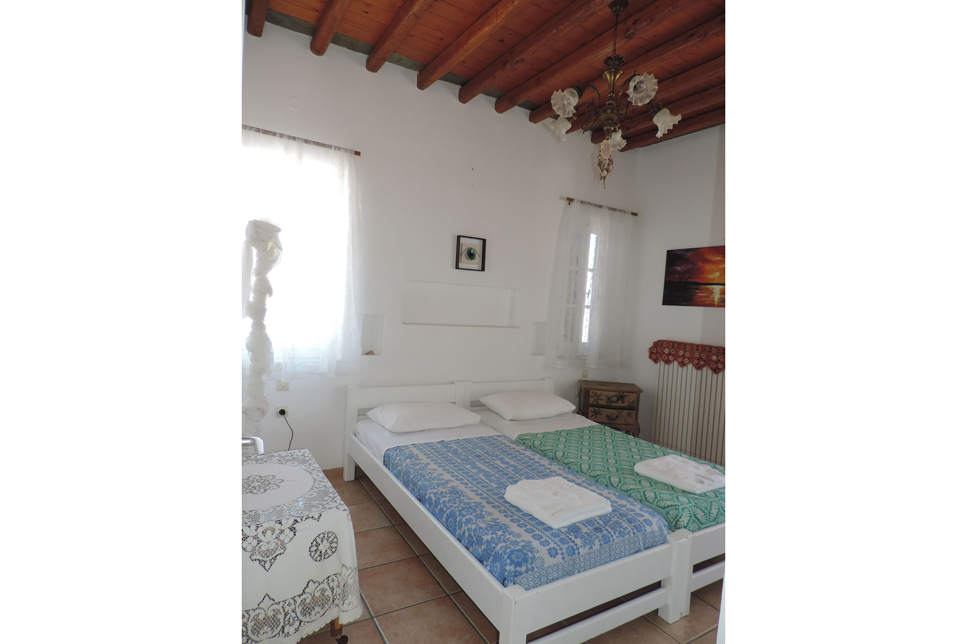 Bedroom with single beds at Elia family house at Kavos